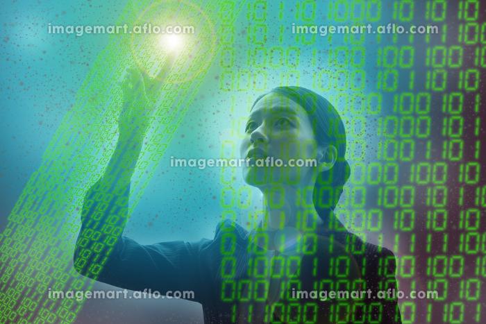 デジタルの仮想空間の中で正解を模索する女性の合成写真の販売画像