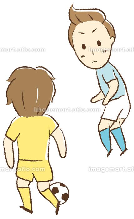 サッカーをする少年 一対一の販売画像