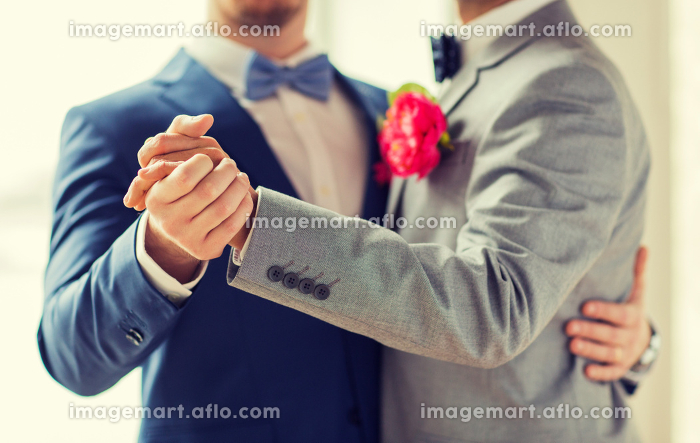 close up of happy male gay couple dancingの販売画像