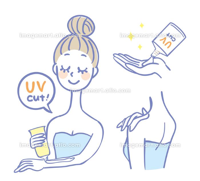 日焼け止めクリームを塗る女性の販売画像