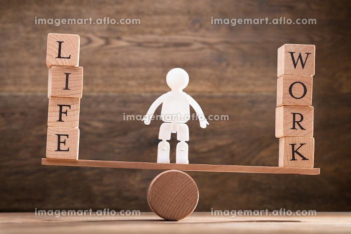 Human Figure Standing Between Work And Life Wooden Blocksの販売画像
