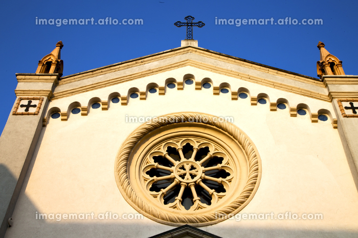 italy  lombardy     in  the   gorla   old   church   closed brick tower   wall rose   window tile