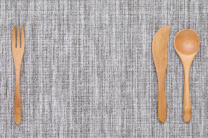 natural wooden spoon and fork, knife on tableclothの販売画像