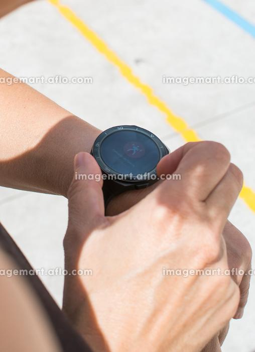 Unrecognizable Sportswoman Checking Smart Watch.の販売画像