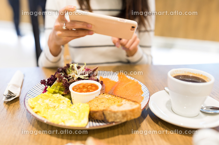 Woman taking photo on her meal