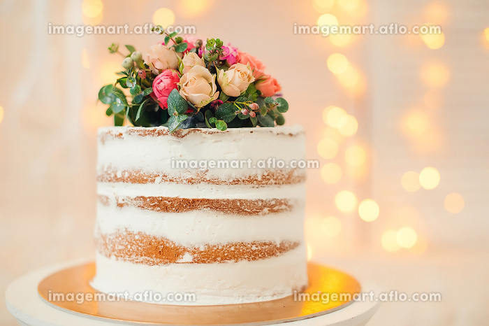 Decorated by flowers white naked cake, rustic style for weddings, birtの販売画像