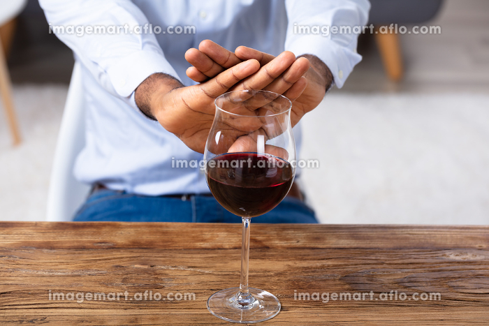 Man Making No Gesture For Glass Of Wineの販売画像