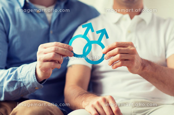 close up of happy male gay couple with love symbolの販売画像