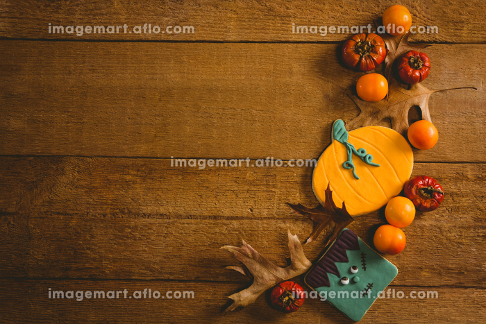 Overhead view of food with autumn leaves on tableの販売画像