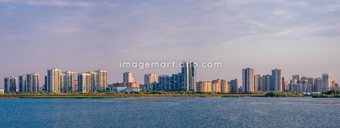 Urban landscape on river bank.の販売画像