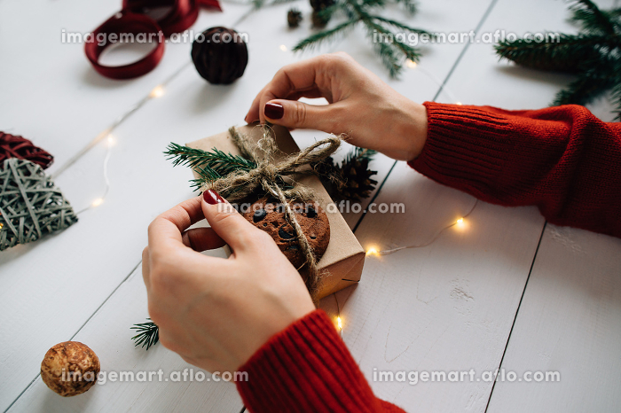 Woman packing a Christmas present.
