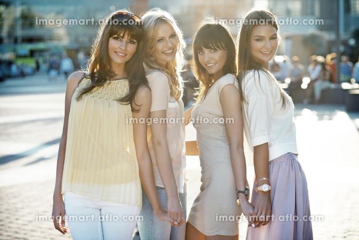 Four beautiful women in casual pose