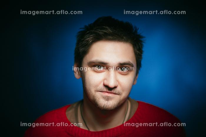 emotional young man photo in studioの販売画像