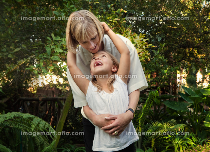Girl hugging mother