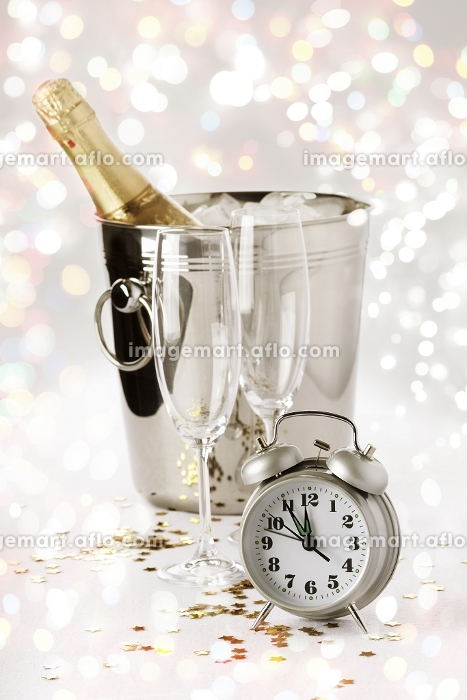 new eve concept with champagne and alarm vintage clock  selective focus on nearestの販売画像