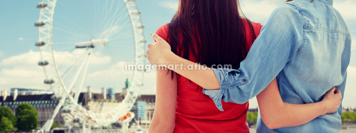 close up of happy lesbian couple over ferry wheelの販売画像