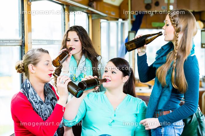 Group of people in tram bar having beer partyの販売画像