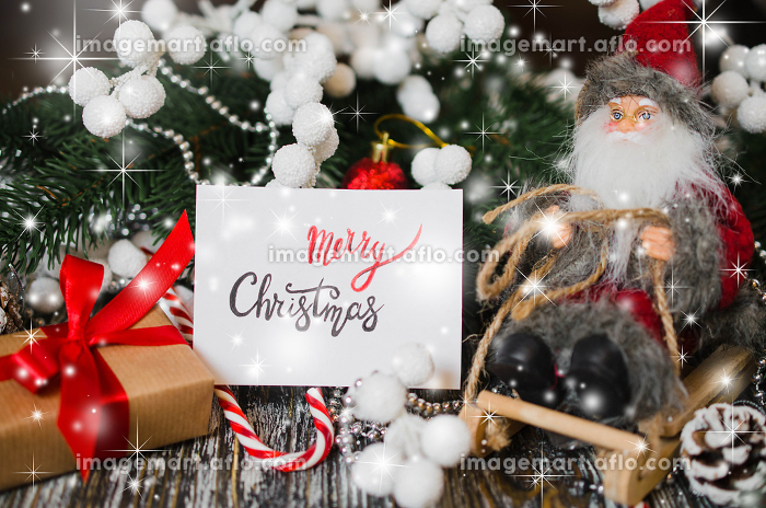 Christmas still life with decorative Santa and gift box.