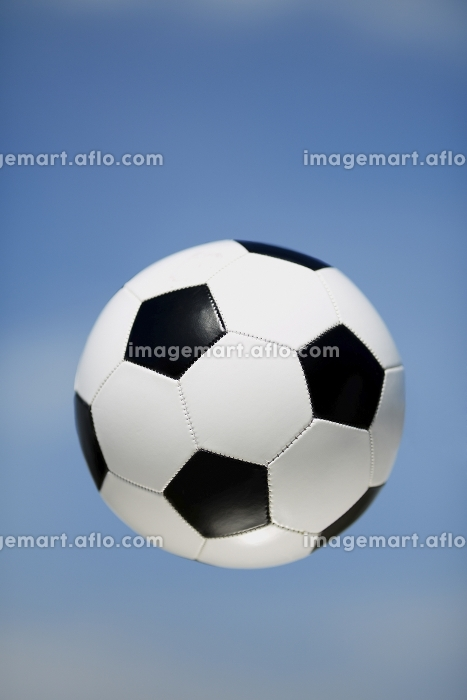 soccer ball on the blue sky background  selective focus on nearest part of ballの販売画像