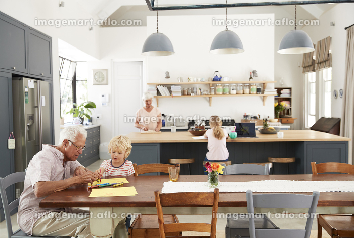 Grandparents and grandkids spending time in family kitchen