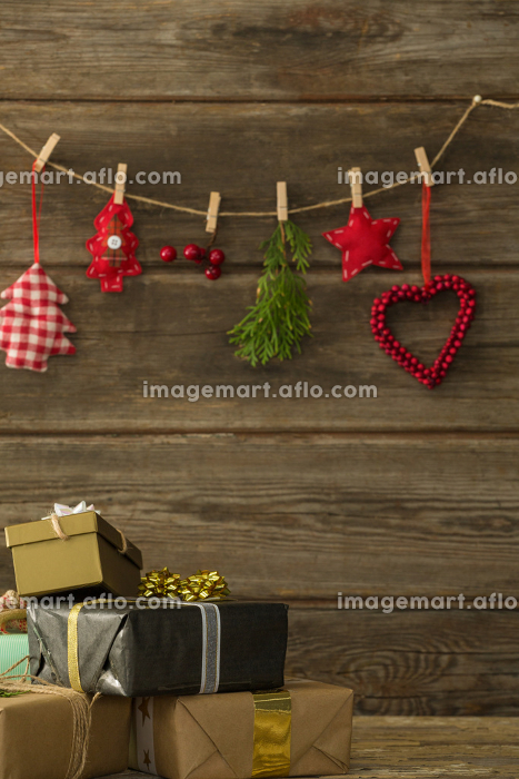 Christmas decorations hanging against wooden wall