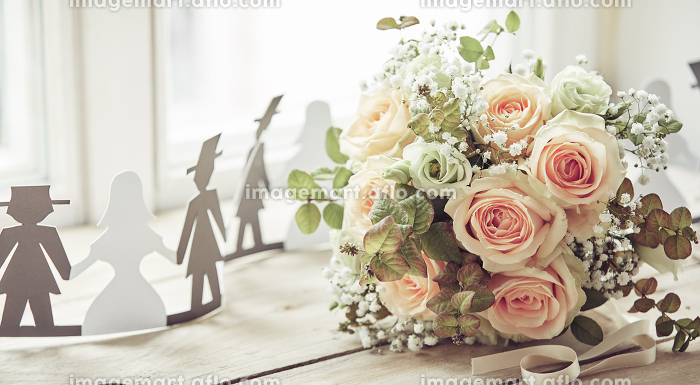 Bride and groom cut out shapes and bridal bouquet
