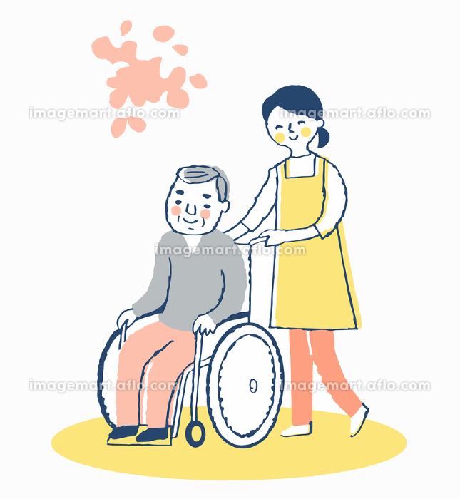 車椅子のシニア男性と女性介護スタッフの販売画像