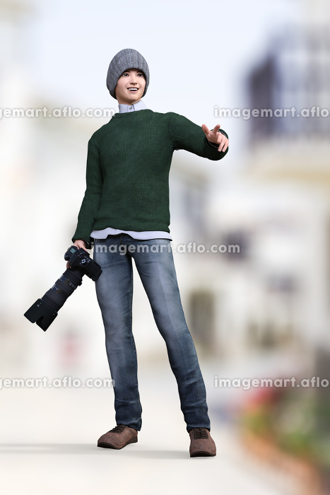 モスグリーンのニットを着た青年が望遠レンズをつけたカメラを片手に撮影しようと被写体を指差している
