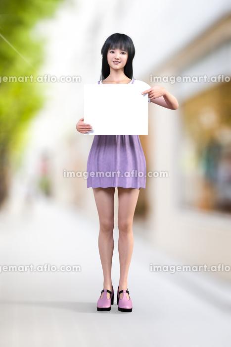 笑顔のロングヘアの黒髪の女の子が白いメッセージがかけそうなフリップを指差しながら持っているの販売画像