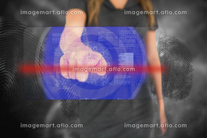 Businesswoman touching blue fingerprint interface touchscreenの販売画像