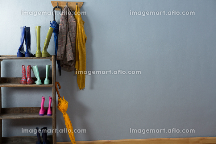 Wellington boots, umbrella and blazer on hookの販売画像