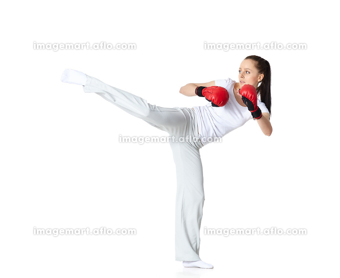 Young woman in fighting glovesの販売画像