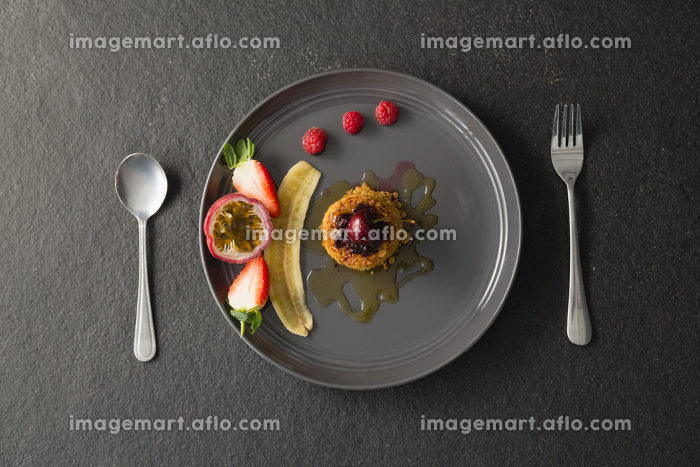 Healthy breakfast with fruits in a plate