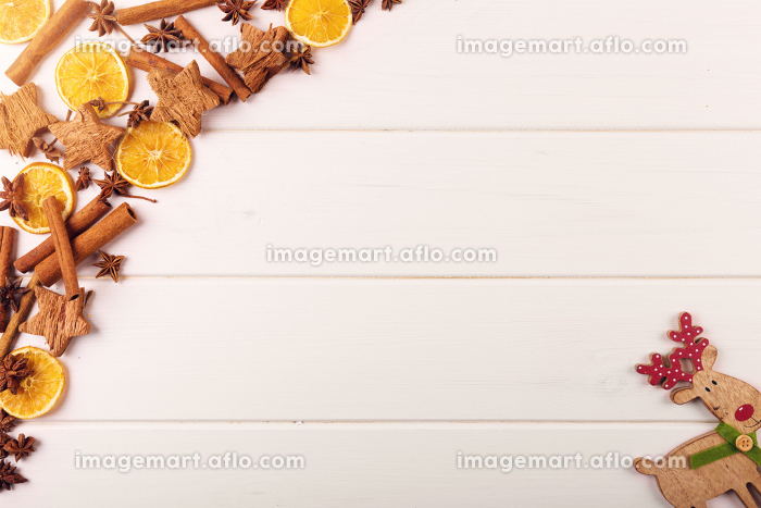 christmas background with spices and reindeer on white wooden table with copy spaceの販売画像