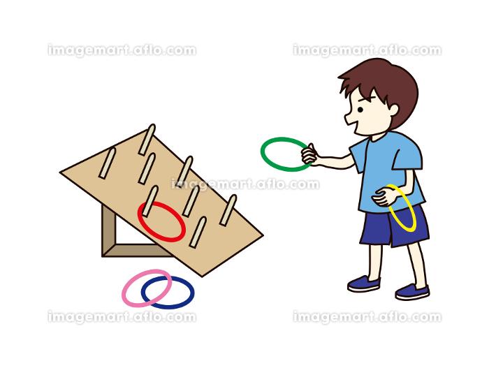 輪投げをする男の子の販売画像