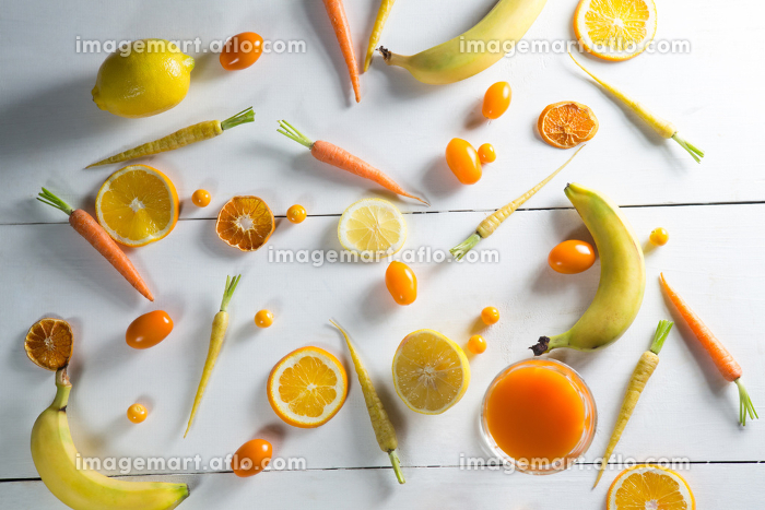 Overhead view of various fruits with juice glass