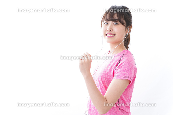 ランニングをする若い女性の販売画像