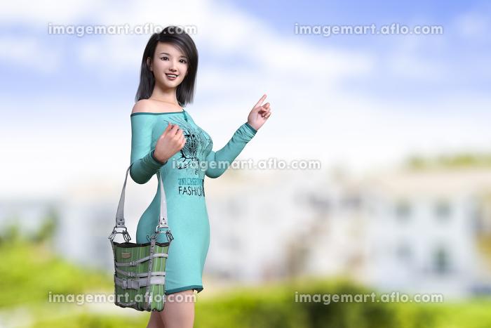 青空で片方の肩を出して長袖Tシャツワンピースを着た黒髪の笑顔の女性が建物が立ち並ぶ景色を指差している