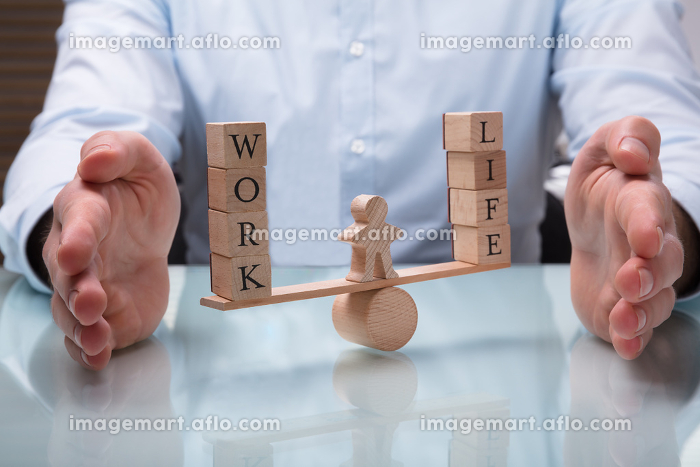 Businessperson Protecting Balance Between Life And Workの販売画像