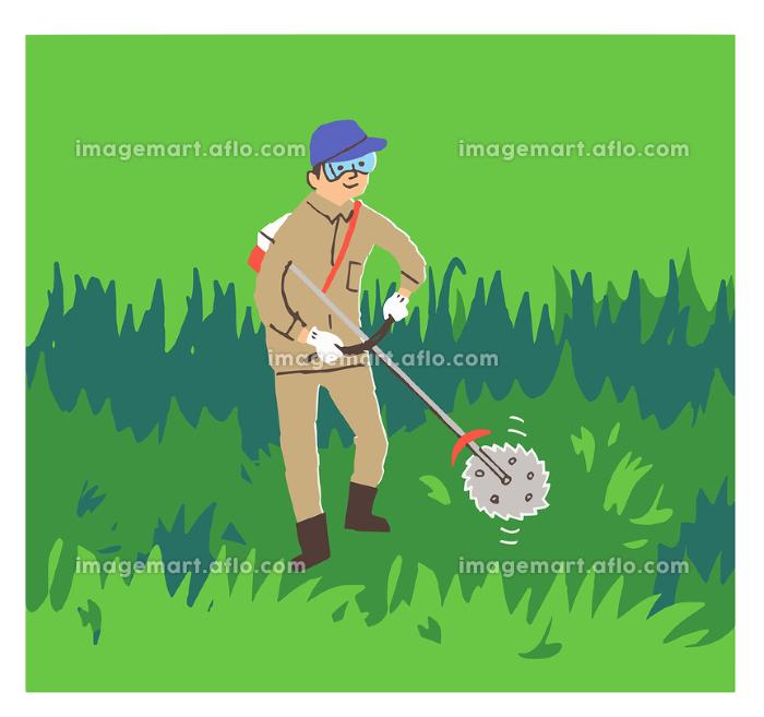 草刈りをする男性