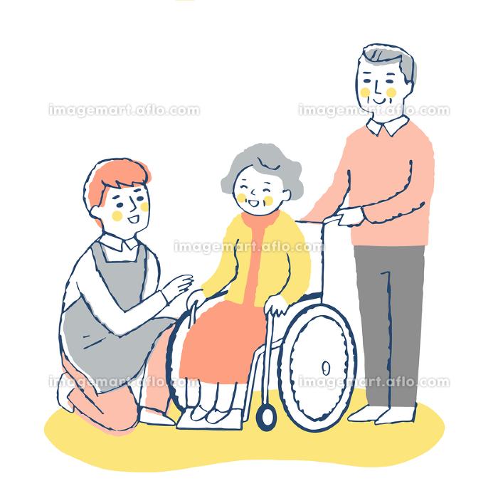 男性介護スタッフと車椅子のシニア女性と夫の販売画像