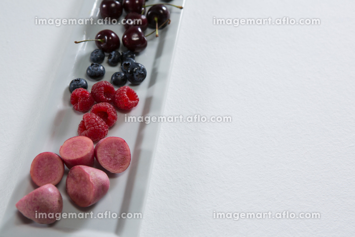 Fruits and vegetables arranged on white background