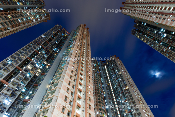 Residential building from low angle at nightの販売画像