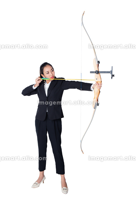 Portrait of concentrated female with crossbow in hands over whitの販売画像