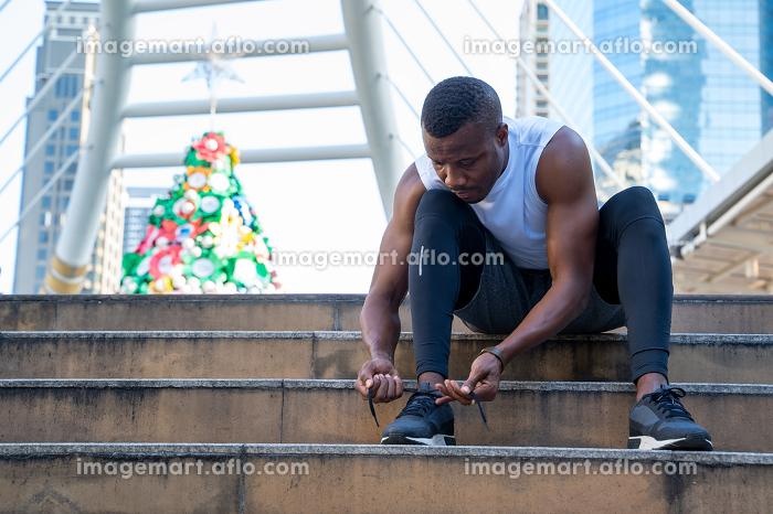 African men tie sport shoe laces before running,People and healt , Bangkok, Bangkok, Thailand