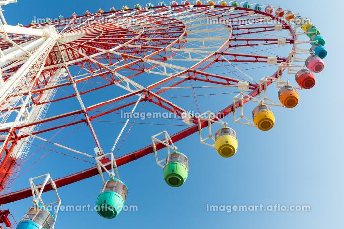 Ferris wheel with blue skyの販売画像