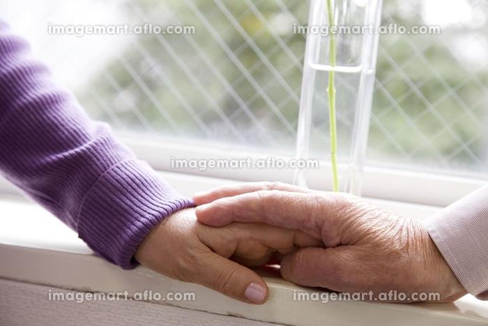 重ねた手の販売画像