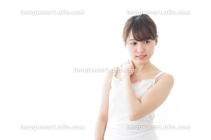 肩こり・関節痛に悩む女性の販売画像
