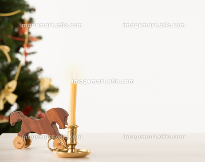 Vintage Wooden Horse on Santa's work table, Christmas Tree on background