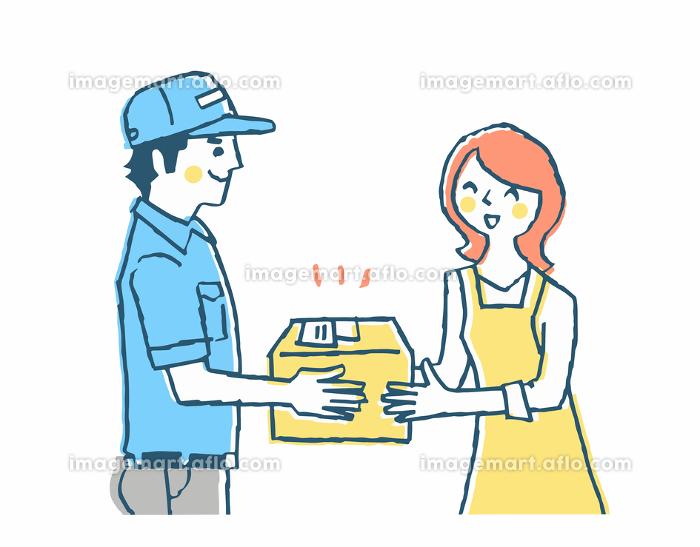 宅配業者と荷物を受け取る女性の販売画像